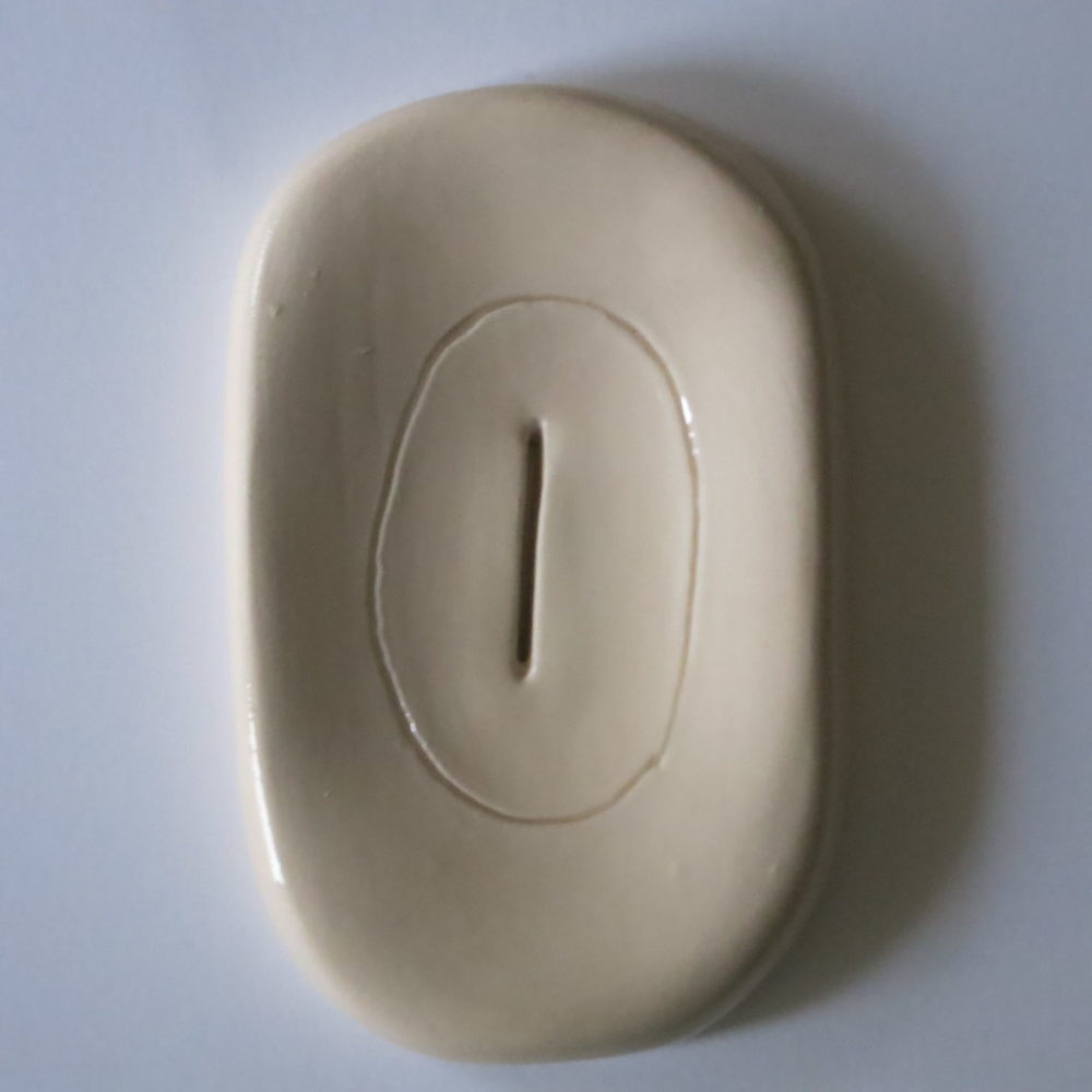 handmade ceramic soapdish female cut